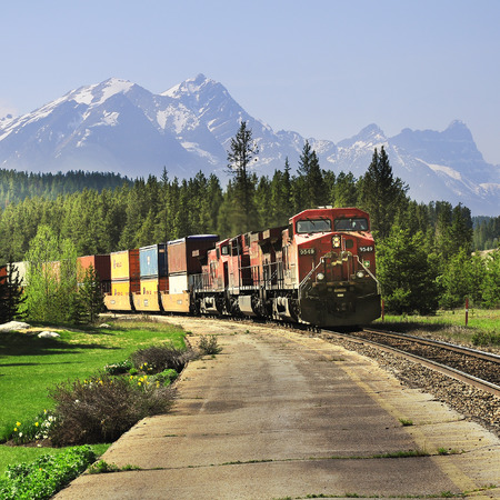 Long freight train after famous spiral tunnels goes from Vancouver to Calgary on June 09, 2011 in Lake Louise, Canada