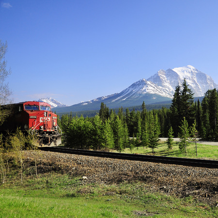 Long freight train goes from Calgary to Vancouver and approach to the station on June 09, 2011 in Lake Louise, Canada