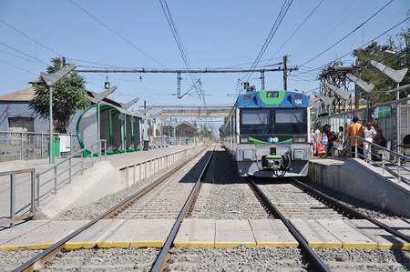 suburbian: Electric train stands on suburbian railway station on February 21, 2013 in Santiago region, Chile   Editorial