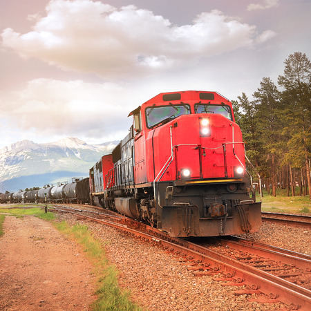 goods train: Freight train departs from Jasper station  Alberta  Canada