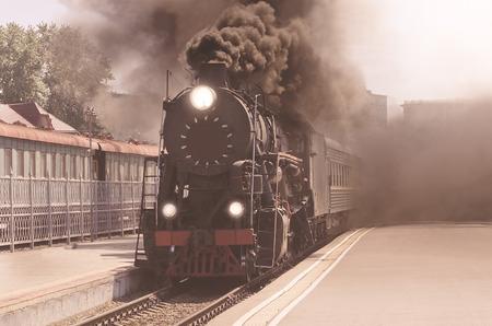 Vintage image of the departure of the retro steam train. Archivio Fotografico