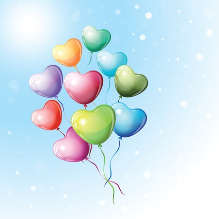Heart shaped colorful balloons fly in the sky.