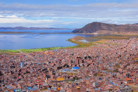 residental: Breathtaking view of Puno by Titicaca lake. Peru. Lake Titicaca is the largest lake in South America and the highest navigable lake in the world.