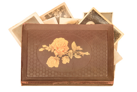 photoalbum: Old photo-album with retro pictures inside it on white background.
