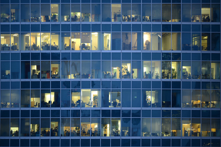 MOSCOW, RUSSIA - FEBRUARY 18, 2015: People work in an offices buildings in Moscow city district, Moscow, February 18, 2015.