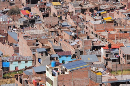 underprivileged: Houses on the streets of the Puno at day time. Peru. Stock Photo