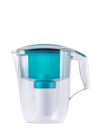 Empty green water filter isolated on white background. photo