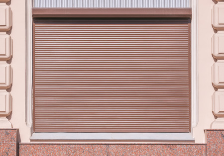 window coverings: Stone wall with the roller shutter window.