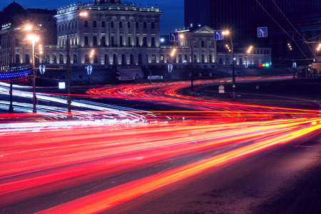 electric avenue: Car lights on the central city streets at evening time.