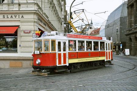 june 25: PRAGUE, CZECH REPUBLIC - JUNE 25, 2010: Vintage excursion tram goes on the central city street, Czech Republic, June 25, 2010. Editorial