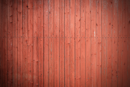 Old brown painded fence. Wood texture background.
