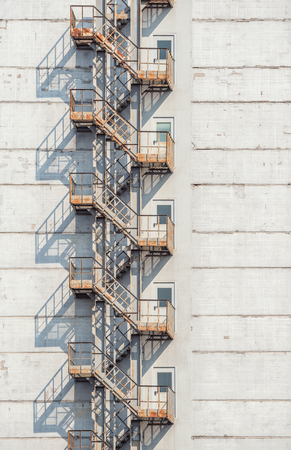 fire escape: View of the exterior of a building with old fire escape.