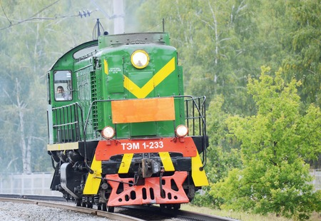 approaches: Moscow, Russia - September 3, 2015: Retro shunting diesel locomotive approaches to the station. EXPO 1520 railway exhibition.
