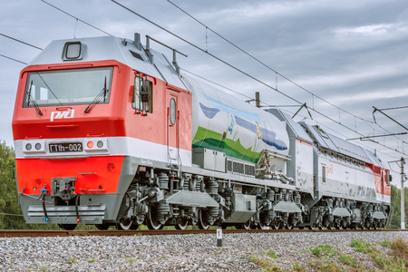 approaches: Moscow, Russia - September 3, 2015: Gas-turbo locomotive approaches to the station. EXPO 1520 railway exhibition in Cherbinka.