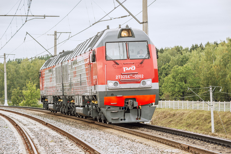 approaches: Moscow, Russia - September 3, 2015: New modern diesel locomotive approaches to the station. EXPO 1520 railway exhibition in Cherbinka.