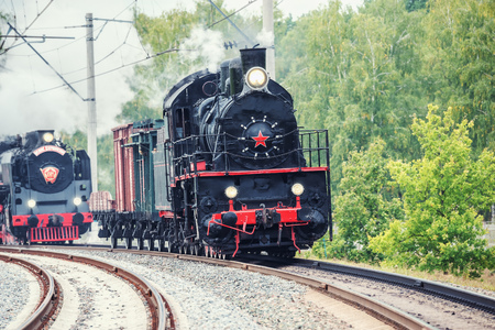 steam locomotives: Moscow, Russia - September 3, 2015: Parade of the retro steam locomotives and carriages. EXPO 1520 railway exhibition in Cherbinka.