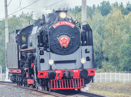 approaches: Moscow, Russia - September 3, 2015: Old retro steam locomotive approaches to the station. Editorial