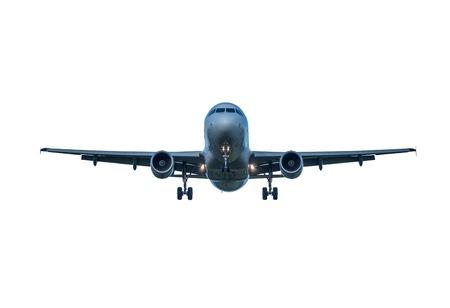 着陸旅客機は、白い背景で隔離。 写真素材