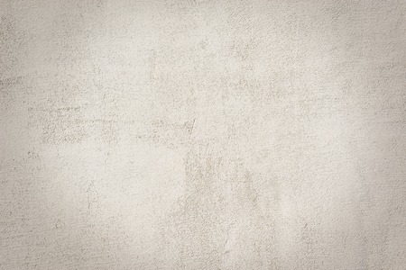 白い壁のテクスチャの背景をセメントします。 写真素材