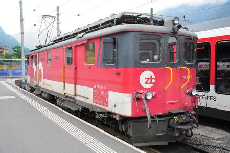 interlaken: Meiringen, Switzerland - July 03, 2012: The electric locomotive stands at the station after arrival from Interlaken.