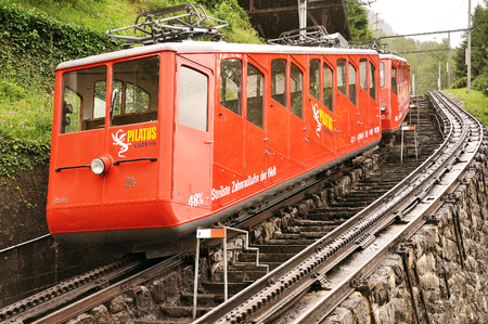 Alpnachstad, Switzerland - July 02, 2012: Funicular railway train to the top of Pilatus mountain stands by the platform. Editorial
