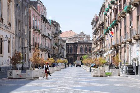 bellini: Catania, Italy -  May 09, 2015: City street to a theater and fountain on Piazza Vincenzo Bellini. Editorial