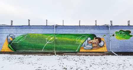 winger: Korolev, Russia - November 27, 2015:  Picture of the soccer player painted on the wall by the city stadium.