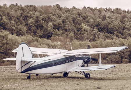 pilot wings: Motion of the old retro plane before taking off. Vintage style image. Stock Photo