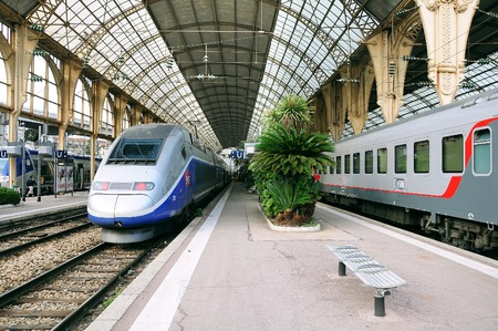 highspeed: Nice, France - May 26, 2012: Passenger international train Nice-Moscow stands by the high-speed TGV train. Train Nice-Moscow goes one time per week. Editorial