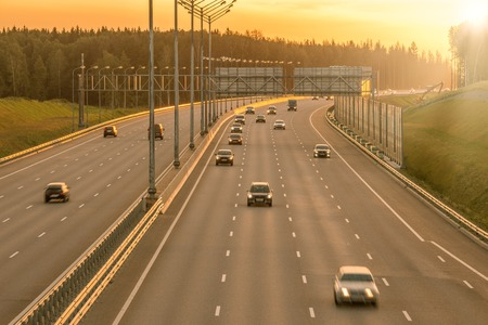 automobiles: View of the new highway at sunset time.