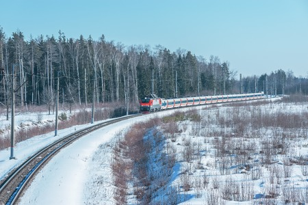 highspeed: Modern high-speed train moves fast at day winter time.