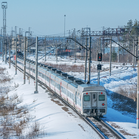 highspeed: Modern high-speed train moves fast through the station. Fryazevo station. Moscow region. Russia. Stock Photo