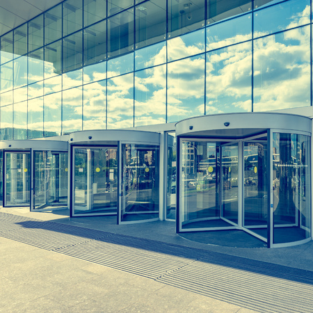 tourniquet: Entrance of the modern business city office building.
