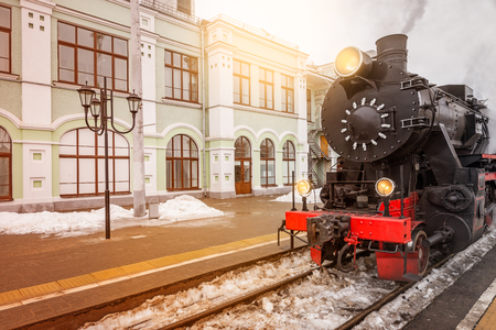 Departure of the retro steam train at spring time.