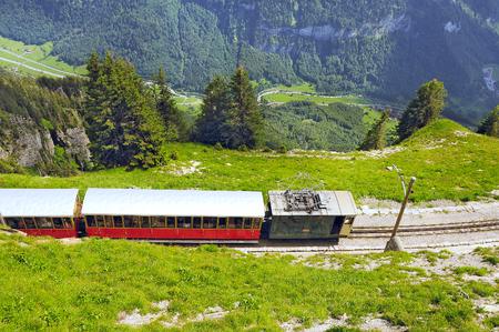 interlaken: Retro passenger train moves from Schynige Platte to Interlaken. Switzerland.