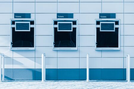 pay wall: Three windows of the stadium ticket offices.