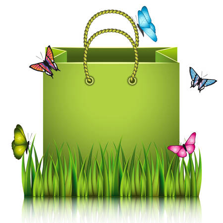 sod: Green paper shopping bag on the meadow grass with butterflies.