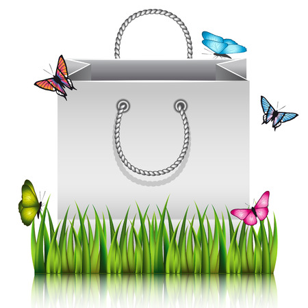 picknick: Gray paper shopping bag on the meadow grass with butterflies.