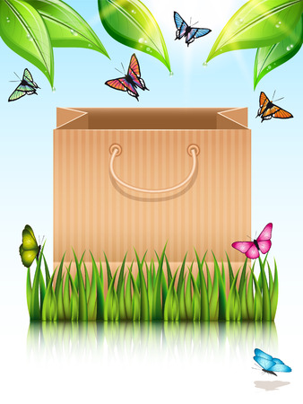 sod: Paper shopping bag under the tree on the meadow grass with butterflies.