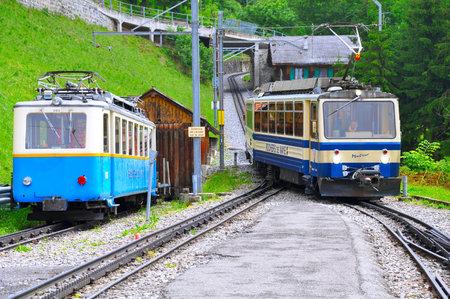 narrow gauge railroads: Caux, Switzerland - June 15 2010: Passenger cogwheel train moves from Haut-de-Caux to Montreux. Editorial