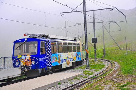 narrow gauge railroads: Haut-de-Caux, Switzerland - June 15 2010: Passenger cogwheel train departs to Montreux. Editorial