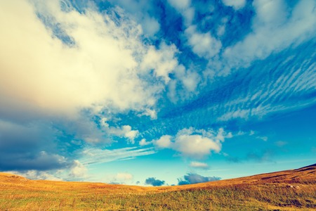 Amazing cloudscape above the mountain meadow. Caucasus. Russia. Stock Photo