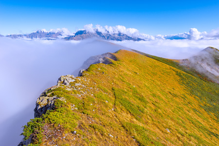Clouds above the mountains at autumn day time. Caucasus. Russia.