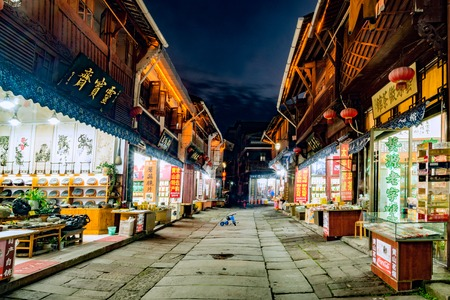 Huangshan, China, December 23, 2016: Evening view of the shops in the historical center streets of the city.