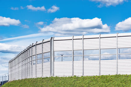 Noise protection fence along the new highway. Stock Photo