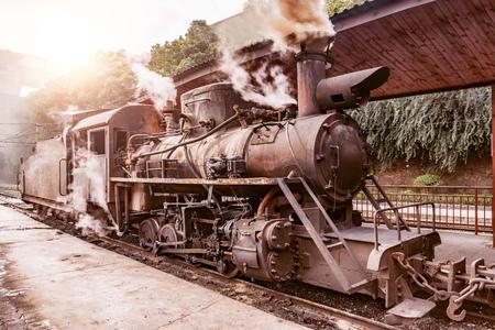 Steam narrow-gauge locomotive stands by the passenger platform. Yuejin. Sichuan province. China.