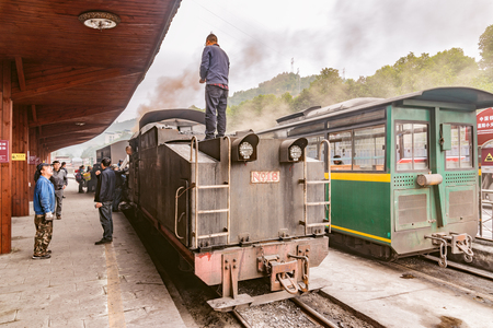 Yuejin, Sichuan province, China, November 03, 2016: Steam narrow-gauge train stands before departure.