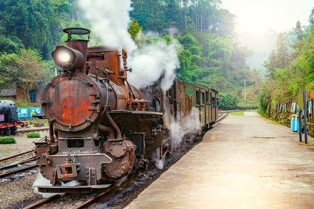 Steam narrow-gauge train with local people stands at the station on the way from Bagou to Yuejin. Mifenguan. Jiayang Mining Region. Sichuan province. China. Stock Photo