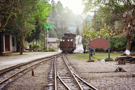 Steam narrow-gauge train stands on the station at early morning time. Mifenguan. Jiayang Mining Region. Sichuan province. China.