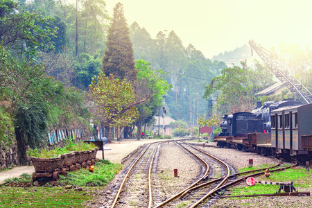 forest railroad: Empty platform at evening time. Mifenguan. Jiayang Mining Region. Sichuan province. China.